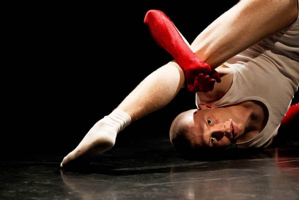 A student performing on black Harlequin Standfast stage floor at Palucca University of Dance