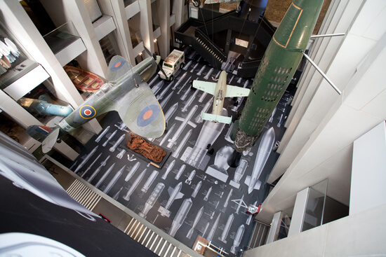 """Top view of the IWM London's atrium, where Ai Weiwei's """"History of Bombs"""" is on display using printed Harlequin Clarity vinyl floor"""