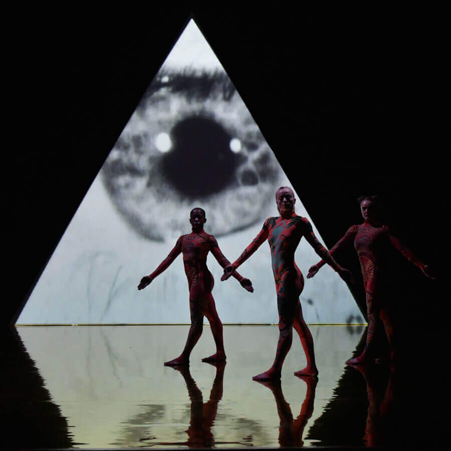 Dancers in front of projection which is reflected on the Harlequin Hi-Shine high gloss floor