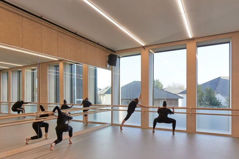 Students dancing and stretching on Harlequin floors at Kingston University