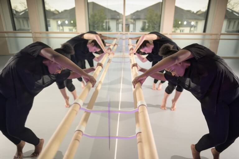Dance mirrors creating the illusion of double the students in the rehearsal studio
