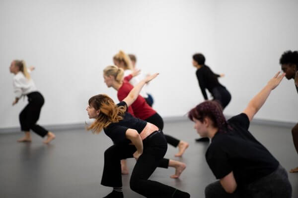 Students in the middle of a fast dance rehearsal
