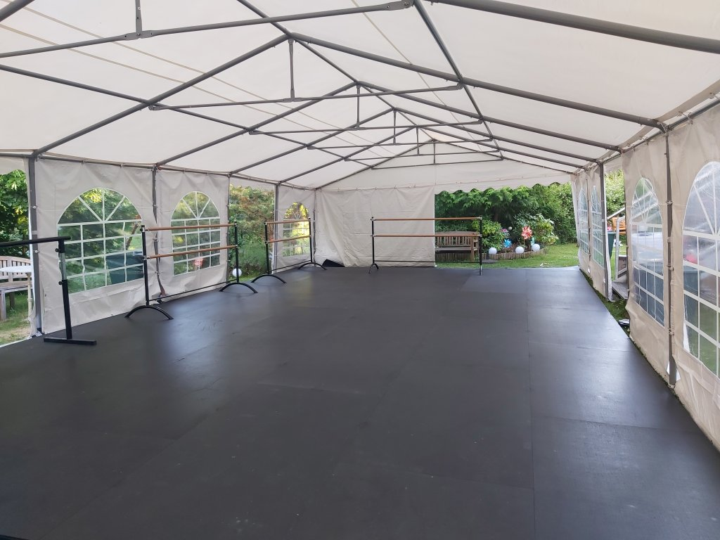 The marquee with the finished Harlequin dance floor and ballet barres