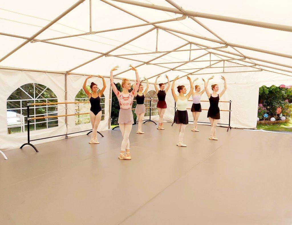 Ballerinas taking a dance class on Harlequin outdoor floor