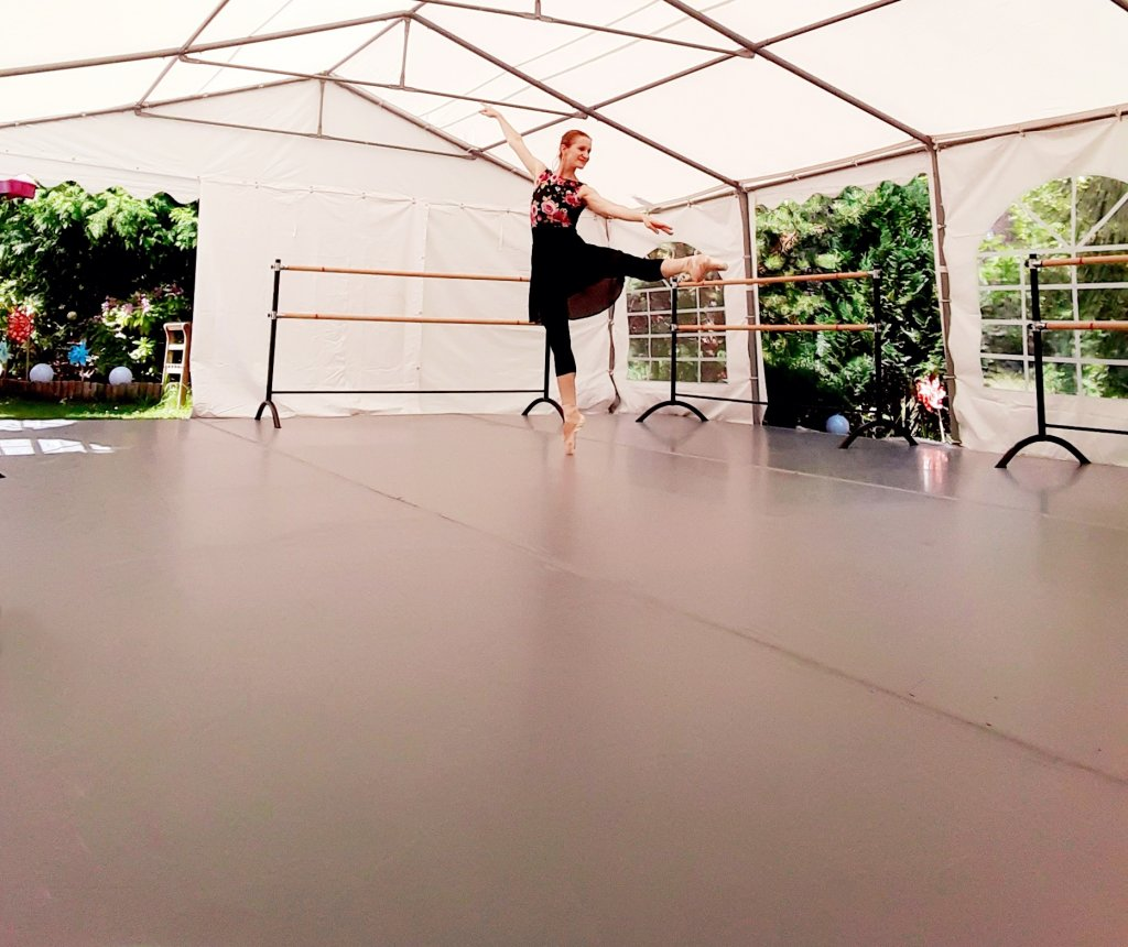 Franziska Rengger dancing on her new outdoor dance floor from Harlequin