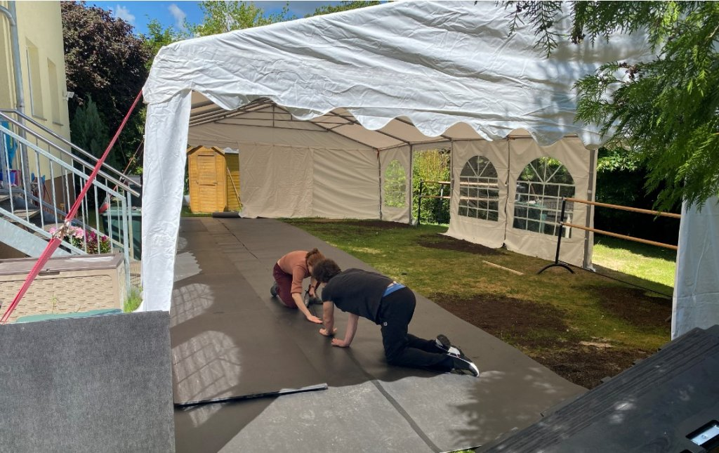 Franziska Rengger and Mikhail Kaniskin installing the Harlequin sprung floor panels