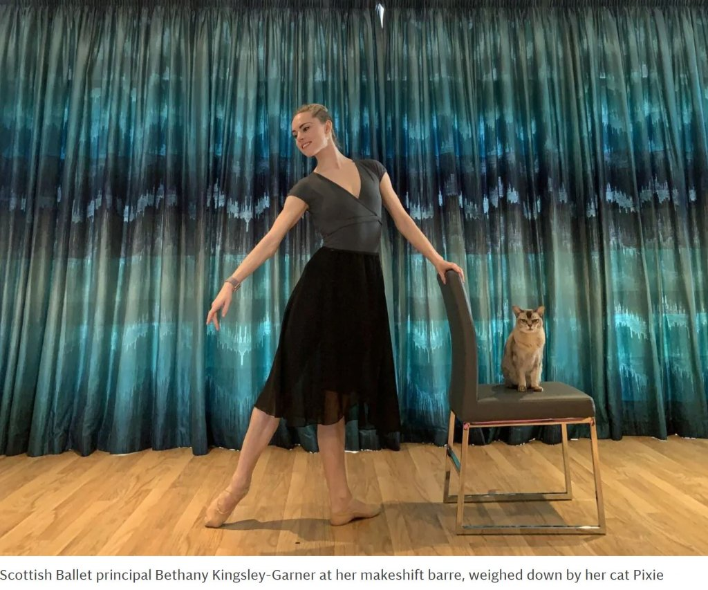 Scottish Ballet principal Bethany Kingsley-Garner at her makeshift barre, weighed down by her cat Pixie