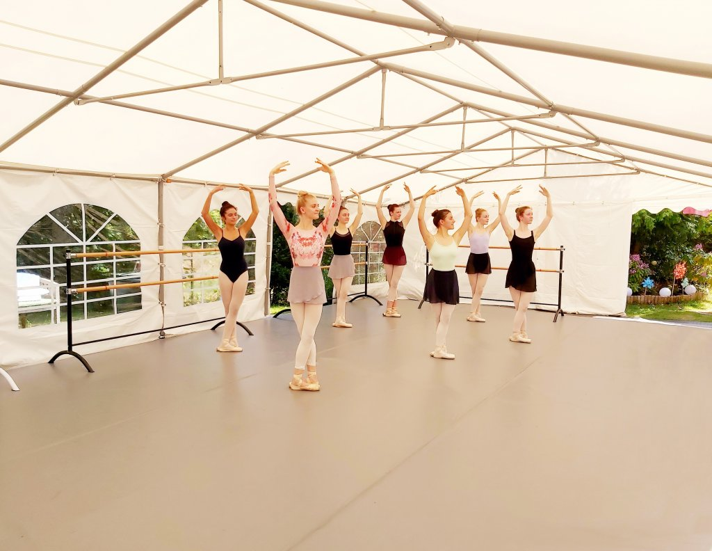 Ballet class inside the marquee