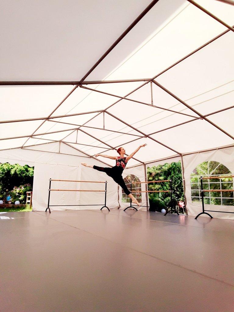 Franziska Rengger dancing on her outdoor Harlequin floor