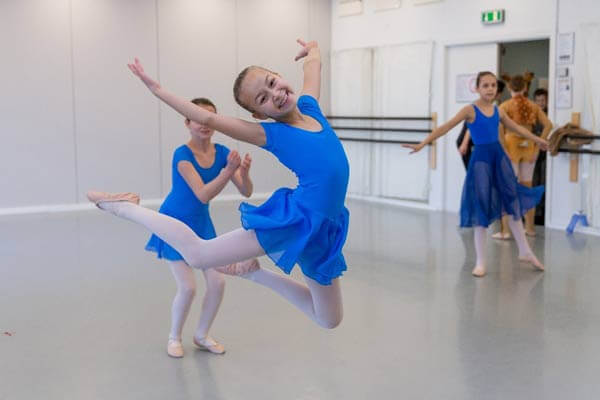 Jumping, smiling ballerina at Ballettskolen Holstebro